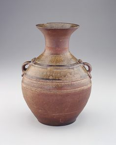 Green-glazed hu-shaped jar 1st century B.C.E.-early 1st century C.E. Western Han dynasty  Stoneware with applied and accidental wood-ash glazes H: 27.7 W: 20.7 cm  China