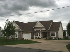 Gorgeous 1.5 story, 4 bedroom home. Spacious open floor plan with beautiful archways and 14' ceilings. Covered deck and fenced backyard. Over 2300 sf  $199,900  Call Rhonda 417-622-2850  www.rhondathompsonrealtor.com