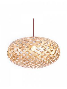 The lamp is formed into an overall airy, oval shape and held in place by aluminum rivets. The resulting crystalline pattern indeed evokes the intricate form of a snowflake as it sheds a warm, distinctive light pattern.