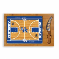 Kentucky Wildcats Cheese Board / Servicing Tray with Cheese Knife - Icon by Picnic Time. Short Description: Sleek and unpretentious in its design, the Icon is perfect for small get-togethers. Natural wood, glass, and stainless steel are merged into a simplistic piece for your entertaining needs. The Icon is a three-piece set that has a solid rubberwood base with a bamboo rim accent, a tempered glass lid, and a cheese knife with its own carved out area in the wood base. So simple and elegant…