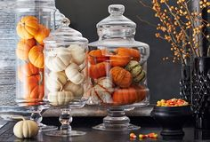 A clear canister, such as an apothecary jar, makes for an instant Halloween display with the help of those undeniably adorable mini pumpkins you've been eyeing at the market (we're right there with you).