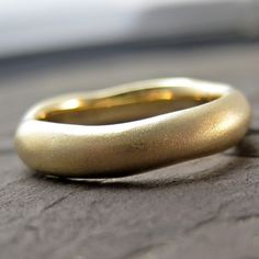 What a gorgeous looking wedding ring. This is an Etsy find from a shop owner called Kristin Coffin. She uses recycled gold and all sorts of organic styling - quite lovely indeed.