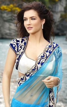 Blue net saree and blouse with short jacket