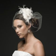 Can't get enough of this #Veil !  Love how it wraps around the #bun  #Wedding Hair Photos on WeddingWire