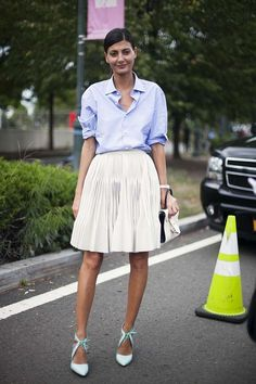 Love the pairing of a simple button-down with a spring skirt.