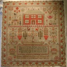 Esther Iddison sampler 1847.  A lot of red -- can't have too much of that, though.  This one is not as interesting to me as a lot of the others I've pinned. I do like the house, and some of the floral motifs are interesting.
