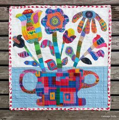 colorful folk art flowers by Cathy at Cabbage Quilts: 2014 Quilt and Craft Expo