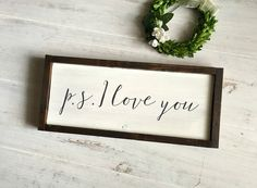 PS I Love You Sign, Rustic Wood Love Sign, Love Decor, Rustic Nursery Decor, Woodland Decor, Anniversary Sign, Bedroom Sign, Boyfriend Gift  A timeless phrase for your special person. This sign features a dark walnut stained frame, a painted white background with the phrase p.s. I love you written in a beautiful script in dark gray acrylic. This sign is very versatile- it can be displayed in a family room for all of your loved ones to see, on a shelf above your bed or hung in your little…