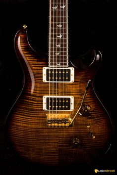 """USED - PRS Custom 24, 30th Anniversary - Wood Library Limited - Black GoldA very small percent of the maple trees cut in North America are actually figured. To make """"10-Top"""" status, a PRS top must have clearly defined figure across its entire top with no """"dead"""" spots. A guitar designated as a 10-Top will usually have a"""
