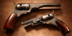 """Colt Paterson Revolvers – Colt Paterson Revolvers – Today, Samuel Colt is a household name. In 1836, however, he was just a fledgling gun maker in Paterson, New Jersey. The Paterson was a five-shot revolver that looks odd to us today because it has no visible trigger or trigger guard. Folding up into the frame, the trigger only emerged when the hammer was cocked. Our GOTD is a """"two-fer"""" – featuring one full-size .36 caliber version and one """"baby"""" .28 caliber version of the Paterson revolver."""
