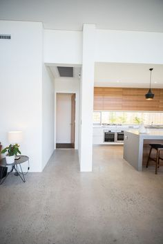 *Polished Concrete* Red Tail Homes Sleek Concrete Kitchen Concrete Kitchen Floor, Polished Concrete Flooring, Smooth Concrete, Kitchen Flooring, Caesarstone Concrete, Polished Concrete Kitchen, Concrete Bedroom Floor, Stone Benchtop Kitchen, Finished Concrete Floors