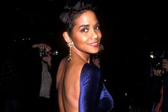 Halle Berry is gearing up to celebrate her 50th birthday this Sunday (August 14) so we couldn't let this throwback Thursday go by without taking a look at her iconic '90s style. From the red carpet to just another day in the neighborhood, these are Halle's standout style moments from back in the day.