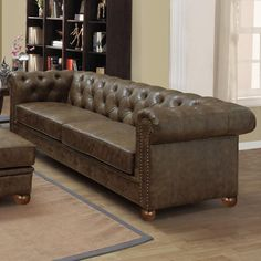 Tufted bonded leather sofa with nailhead trim.Product: Sofa    Construction Material: Bonded leather upholstery and wo...