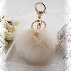 LAST ONE* Faux Fur Key Chain w/ Pearl Cream This is a brand new Pom Pom key chain/purse accessory. Gold chain. Beautiful pearl attached to keychain. Faux rabbit fur. Color cream. Comes with original plastic- this is brand new retail. My price is firm because it is half the price of other sellers that are selling for $12-$15. Never lose your keys with this adorable Pom Pom or decorate your purse with the latest must-have handbag trend, and your purse will thank you!  Accessories Key & Card…