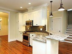 J.R. Huntley Homes Raleigh, NC gray subway tile, industrial pendants, granite, white cabinets