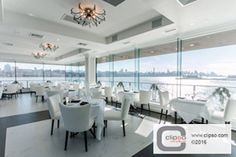 Orama Restaurant - Edgewater, NJ. 705PA Pearlescent fabric in Blanc Argent and LA 53 acoustic batting. Installer: NY Ceiling