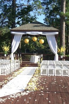 Wedding Flowers. Yellow. Gazebo Decor. Curtains. Tulle. Aisle Runner. Rose Petals. Paper Lanterns. Pew Decor. The Woodlands Resort and Conference Center. http:thebloomingidea.blogspot.com