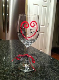 Shop for valentines on Etsy, the place to express your creativity through the buying and selling of handmade and vintage goods. Wine Bottle Glasses, Diy Wine Glasses, Decorated Wine Glasses, Wine Bottle Art, Hand Painted Wine Glasses, Wine Bottles, Wine Glass Crafts, Wine Craft, Wine Bottle Crafts