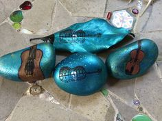 """These are a few of the painted rocks and leaves that we """"abandoned"""" for folks to find at the Florida Folk Festival 2016.  Inspiration for the leaf and the guitar/moon/trees rock was from an image on the web and Facebook."""