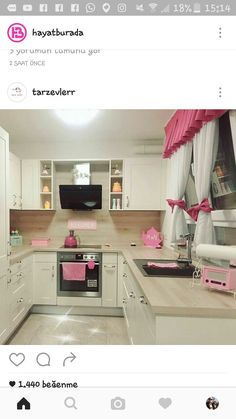Cute PINK tea kettles and retro radiol..and the tv flanked with open shelves with pastel lovelies..above that flat cook top, great tiny kitchen goals!