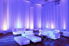 Beautiful wall draping with lilac lighting