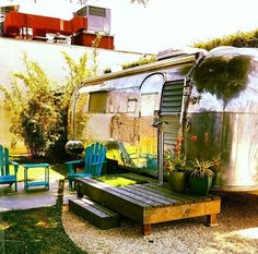 Camp in a vintage airstream with your own patio, grill and Adirondack chairs.