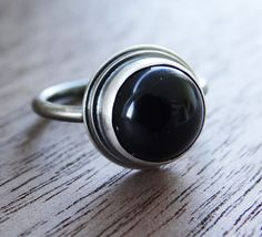 Black Onyx and Sterling Silver Ring by Scape on Etsy https://www.etsy.com/uk/listing/475388777/black-onyx-and-sterling-silver-ring