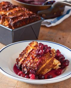 """Cranberry-Maple Bread Pudding ~~~ This bread pudding is a delicious (and beautiful) way to use a week-old loaf. The crowning glory is the sweet-tart cranberry-and-maple compote. Recipe and image reprinted with permission from """"Tartine Bread,"""" by Chad Robertson, with photographs by Eric Wolfinger."""