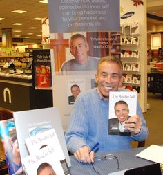 """The Soulful CEO John B. Goodman signs copies of his memoir, """"The Road to Self,"""" at the Barnes and Noble Booksellers store in Roseville, Minn., on Dec. 4, 2015."""