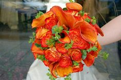 Roses and calla lilies in oranges