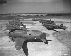 """Brand new Douglas C-47s ('Skytrain') on the tarmac at an unidentified air field in North Carolina. One of the most successful airplane types in aviation history, the C-47, known as the """"Dakota"""" (RAF designation) was an evolution of the DC-3 civilian airliner. More than 10,000 """"Dakotas"""" were produced during WW2 and the plane remained in service with many air forces well into the 1960s."""