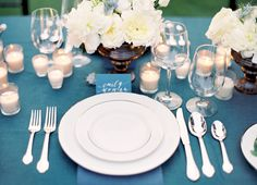 blue linens but in cobalt, with white floral centerpieces