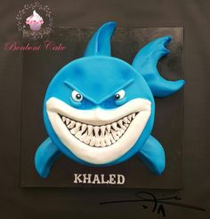 2d shark cake ,a friend of my son choose it becouse he love sharks A cake is sponge with mousse chocolate