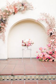 Peach and sage painted paper fans in an arch shape on the ceremony backdrop with roses and pink painted greenery on one side and coral charm peonies framing the other side by The Dainty Lion, Estancia La Jolla Garden Courtyard wedding by Cavin Elizabeth P Neutral Wedding Decor, Whimsical Wedding, Floral Wedding, Wedding Flowers, Ceremony Backdrop, Ceremony Decorations, Coral Charm Peony, Courtyard Wedding, Flower Installation