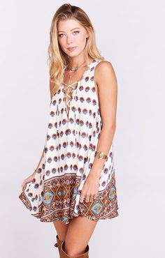 No you aren't seeing things, this lace up tunic tank is absolute perfection.  Wear with your bitty cut offs peeking out or on it's own when it is just too hot for anything else.  Divine over bams on these chilly spring mornings.    *MADE IN THE GORGE USA* *100% Poly *Laces up front *Lined  *Can be worn as tunic or short dress *Basically Wrinkle-proof.  Throw in purse for later recommended
