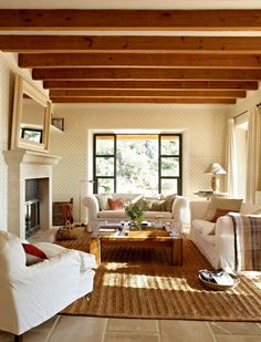 Love the warmness of the light brown rug, beans on the ceiling, etc., along with the clean, simple look of the white.