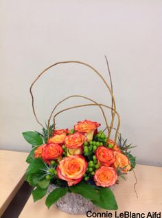 Circus Roses, Green Hypericum Berries, Blue Thistle, Salal & Curly Willow