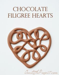 Here's an easy way to make chocolate filigree hearts. These would make the cutest cupcake toppers for Valentine's Day!