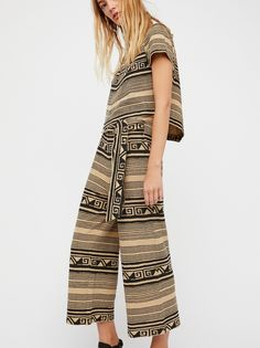 Rip Tide Set   Easy lightweight cotton pants set featured in a tribal-inspired print. * Boxy top is cropped to the natural waist. * Short sleeves and an asymmetrical hem. * Cropped wide leg pants. * Adjustable tie at the waist.