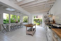 Loving the exposed rafters that give this kitchen its industrial look