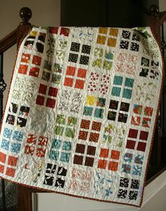 I love this look like you're looking through windows...Think I've found my charm square project!