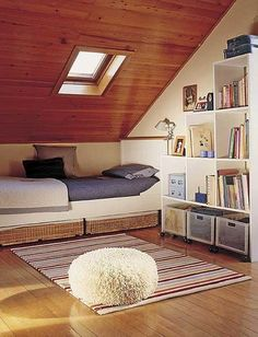 Inspiring attic bedroom ideas that are warm cozy and elegant.--I like the shape of the bed. Also the shelves would work well in the attic