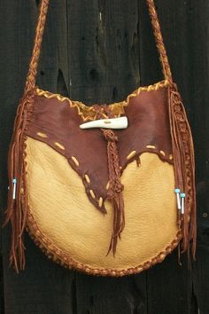 leather purse, bone closure