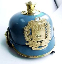 Colonel J's - Articles -Latin American Current helmet of the Venezuela Military Academy, with the new Bolivarian front badge.Note the horse facing left and compare with the previous badge. The change took place in 2007