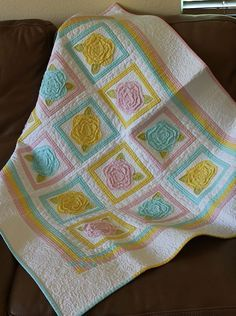 Roses for Katelyn was made for my sweet niece. I used the French Rose Buds pattern and tweaked the design slightly. The solid pastels against the snowy white background make a sugary sweet quilt p...