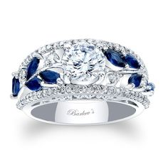 Blue Sapphire Engagement Ring - 7984LBSW - This unique modern engagement ring/diamond wedding band features a round prong set diamond center embellished on the shoulders with gold vines and marquise cut blue sapphires. A ridge of shared prong set diamonds frame the artful shoulders for an elegant touch of glamour. Also available in rose, yellow gold, 18K and Platinum,