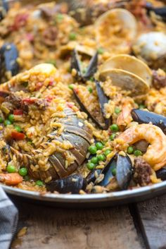 This easy Seafood Paella recipe has authentic Spanish flavor with lobster and lots of other delicious seafood! This traditional dish is also made with chorizo for a complete meal. Seafood Paella, Cuban Dishes, Spanish Dishes, Spanish Food, Shellfish Recipes, Seafood Recipes, Rice Recipes, Meat Recipes, Recipes