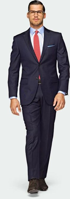 Two piece, modern cut suit - Spread collar shirt - Single Windsor knot necktie, well dimpled - Suede boot - Features: Simple pocket square