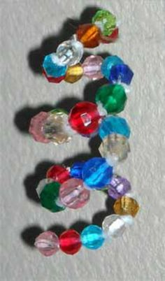 Add color and shine to your Christmas tree with the Spiral Acrylic Bead Ornament for Kids! This easy Christmas craft will be fun for kids of all ages. Easy Ornaments, Beaded Christmas Ornaments, Easy Christmas Crafts, Simple Christmas, Christmas Holidays, Kids Ornament, Christmas Things, Merry Christmas, Bead Crafts