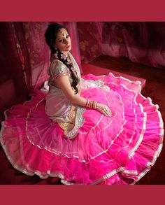 Pink and cream multi tiered net embellished lehenga   1. Pink and cream multi tiered net embellished lehenga2. It is a net pink drape lehenga with cream pallu in shades of lime and pink and antique silver3. Can be stitched upto size 42 inches